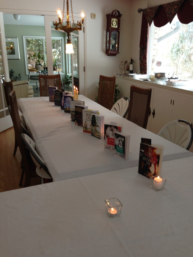 The table is set with all the books that inspired the menu for the luncheon.