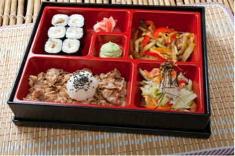 "Another popular lunch item is the bento box. It's a ""set lunch"" that usually involves some kind of fish, some kind of noodles/rice, and some kind of vegetable."