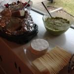 Havarti cheese, Brie, bread, and guacamole.